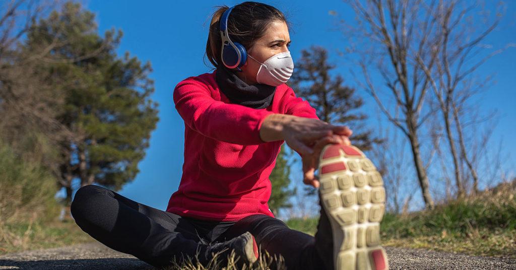 Imagen de ejercicios de calentamiento para un medio maratón.